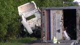 Four people hurt in semi truck accident on 24 EB