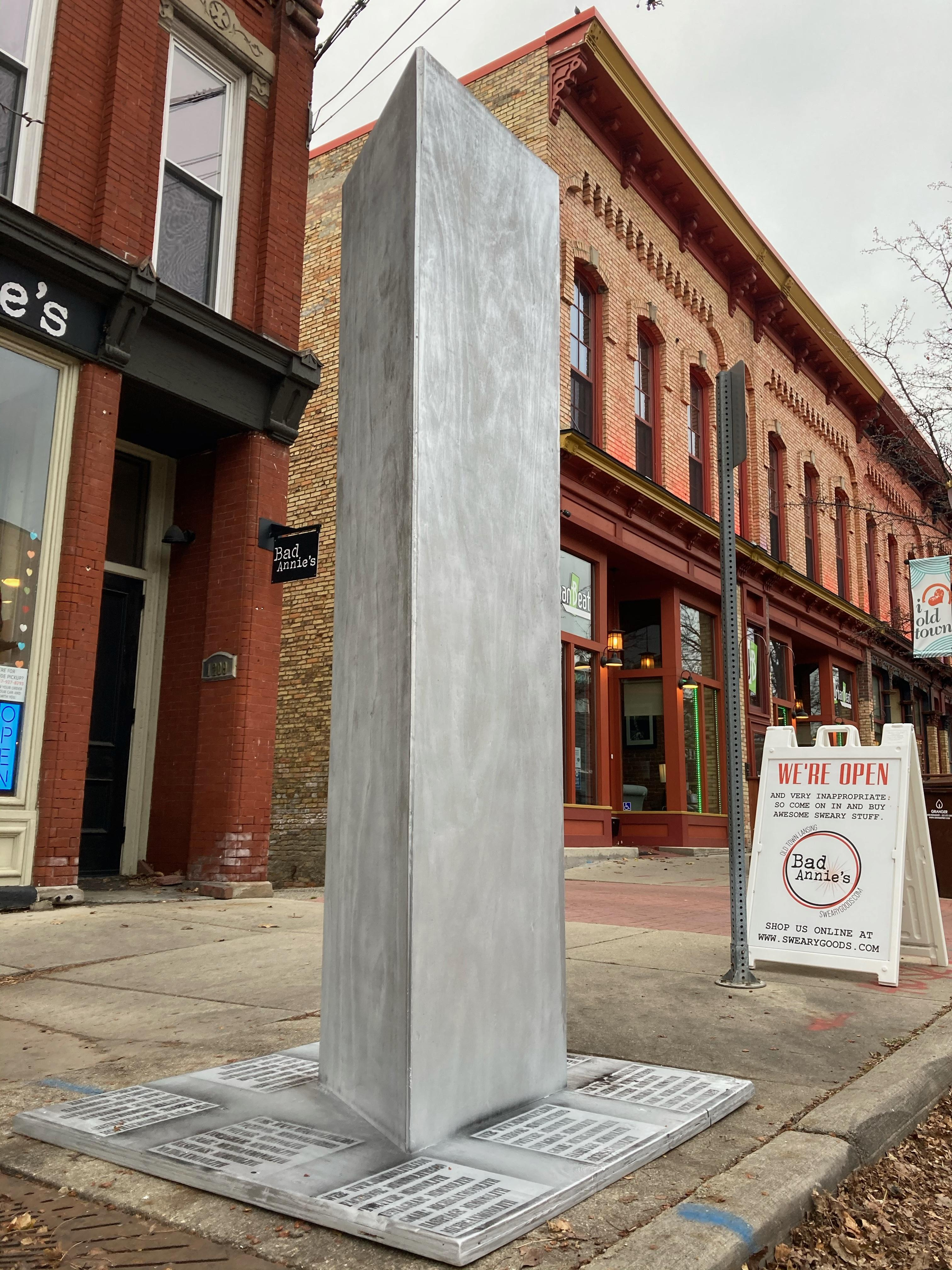 A monolith, mimicking others that have appeared in spots around the globe recently, appeared overnight in Lansing, Michigan, on Tuesday, Dec. 8, 2020, in the city's Old Town district. (WWMT/ Rachel Louise Just)