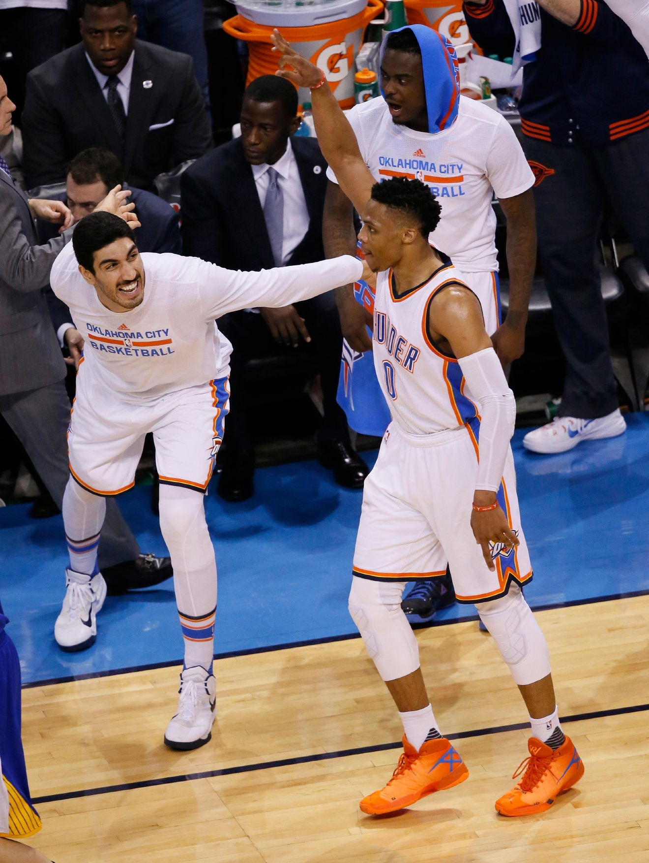 Oklahoma City Thunder guard Russell Westbrook (0) celebrates with teammate Enes Kanter, left, following a basket against the Golden State Warriors in Game 4 of the NBA basketball Western Conference finals in Oklahoma City, Tuesday, May 24,, 2016. The Thunder won 118-94. (AP Photo/Sue Ogrocki)