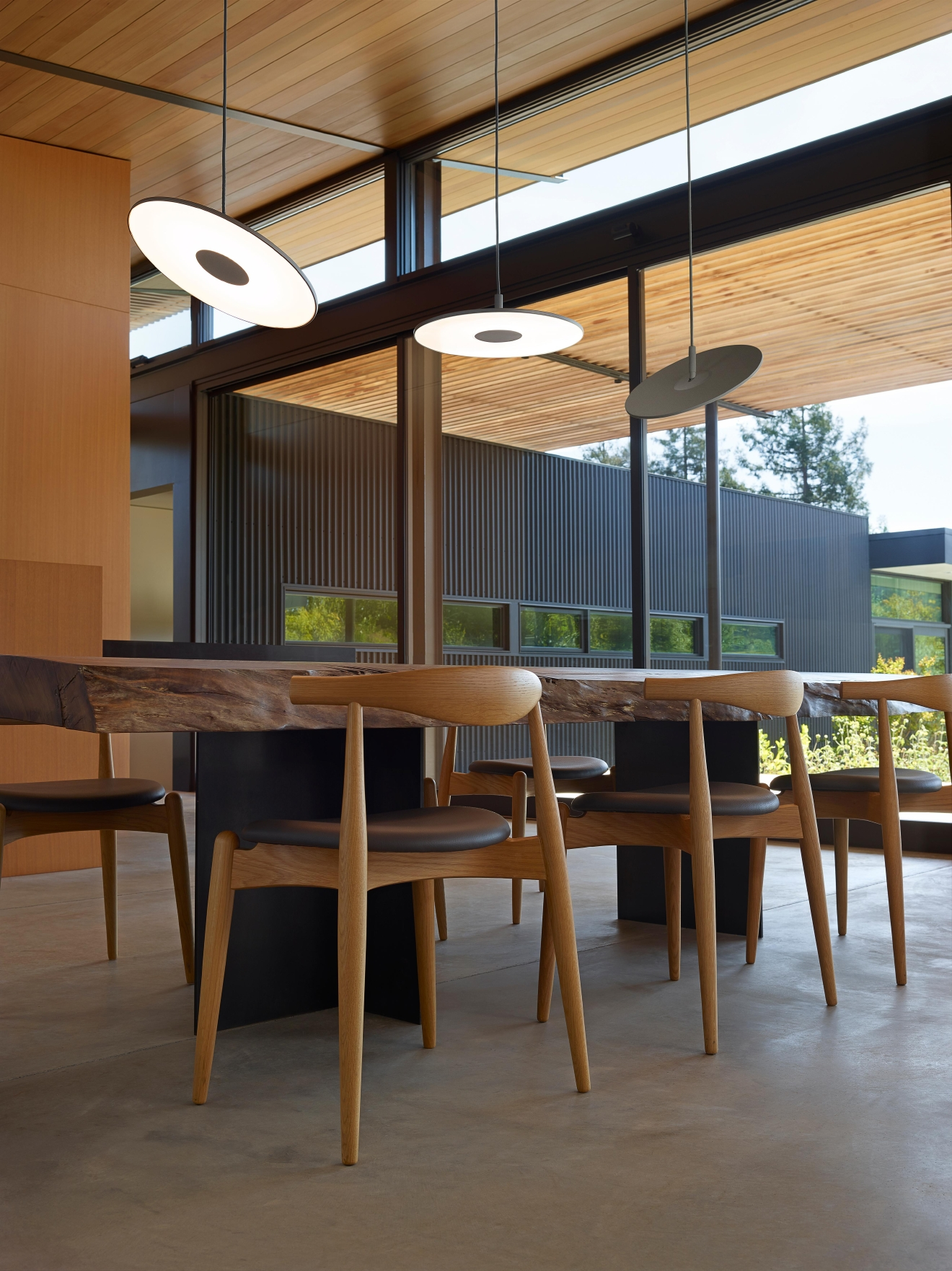 Hanging lights draw the eye upward and leave valuable table and floor space open for use.