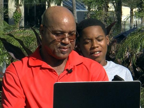 Cornelius Bennett shows his son a video of his famous sack of Notre Dame quarterback Steve Beuerlein.