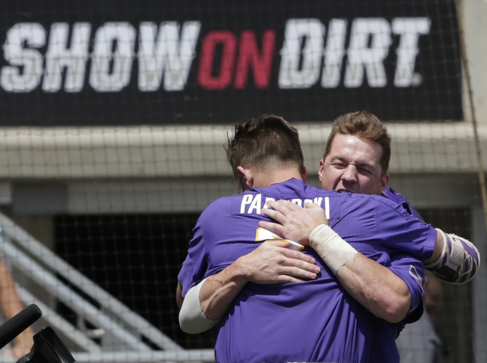 LSU's Michael Papierski (2), hugs Greg Deichmann, right, after scoring on his three-run home run against Oregon State in the third inning of an NCAA College World Series baseball elimination game in Omaha, Neb., Saturday, June 24, 2017. (AP Photo/Nati Harnik)