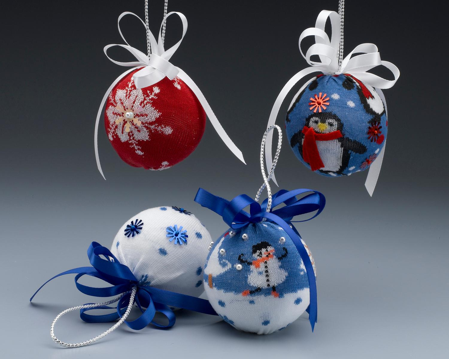 Sock it to 'em (in a good way) with these cute Sock Ornaments.(Image: Kathleen George/Crafts 'n Coffee) Link: http://craftsncoffee.com/2012/12/18/heres-how-to-make-dollar-store-christmas-sock-ornaments/