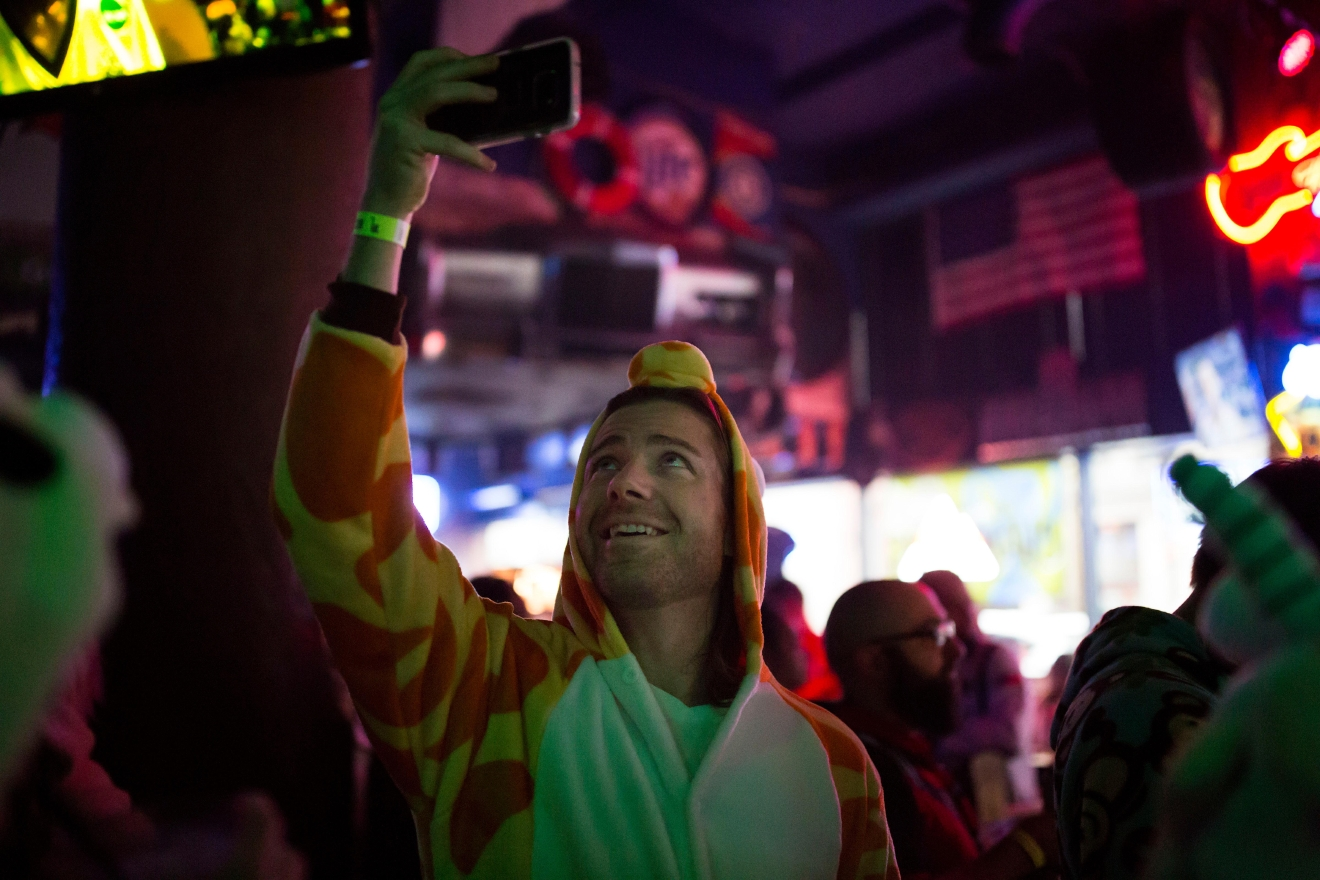 Hundreds gather at Cowgirls Inc. to begin Onesie Mania, a night of bar crawling dressed in onsie pajamas. (Sy Bean / Seattle Refined)