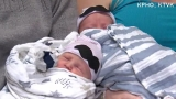 Twins delivered minutes apart have different birth years