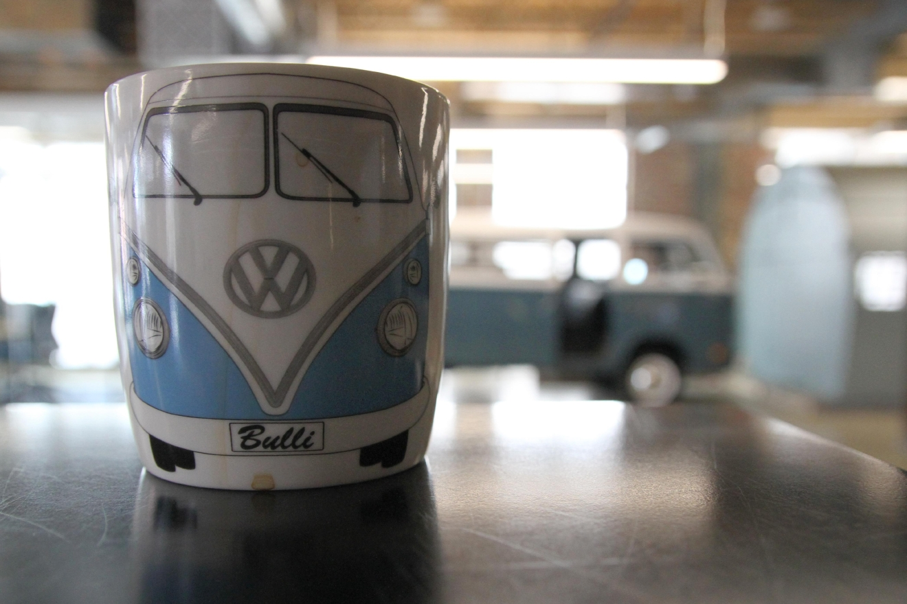 One of the first things to gawk at (and there are many) when walking into ISL is their blue VW bus, which has been immortalized on an employee's coffee cup. (Amanda Andrade-Rhoades/DC Refined)