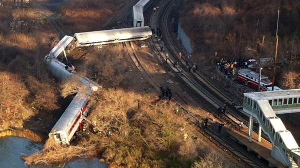 Cars from a Metro-North passenger train are scattered after the train derailed in the Bronx neighborhood of New York.