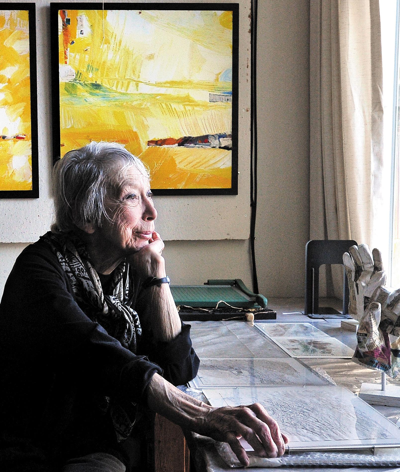 Ashland artist Charu Colorado, then 91, sits in her studio in 2011. Tidings file photo