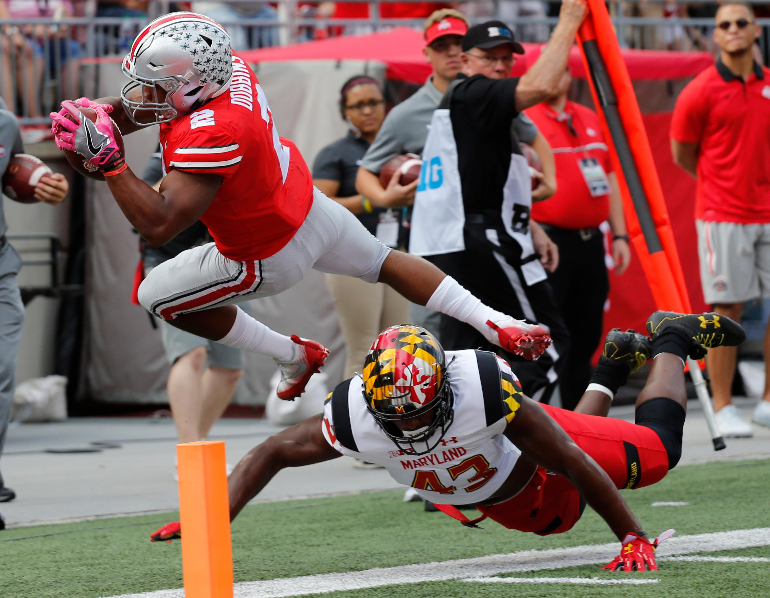 Maryland linebacker Jalin Brooks, right, forces Ohio State running back J.K. Dobbins out of bounds during the first half of an NCAA college football game Saturday, Oct. 7, 2017, in Columbus, Ohio. (AP Photo/Jay LaPrete)