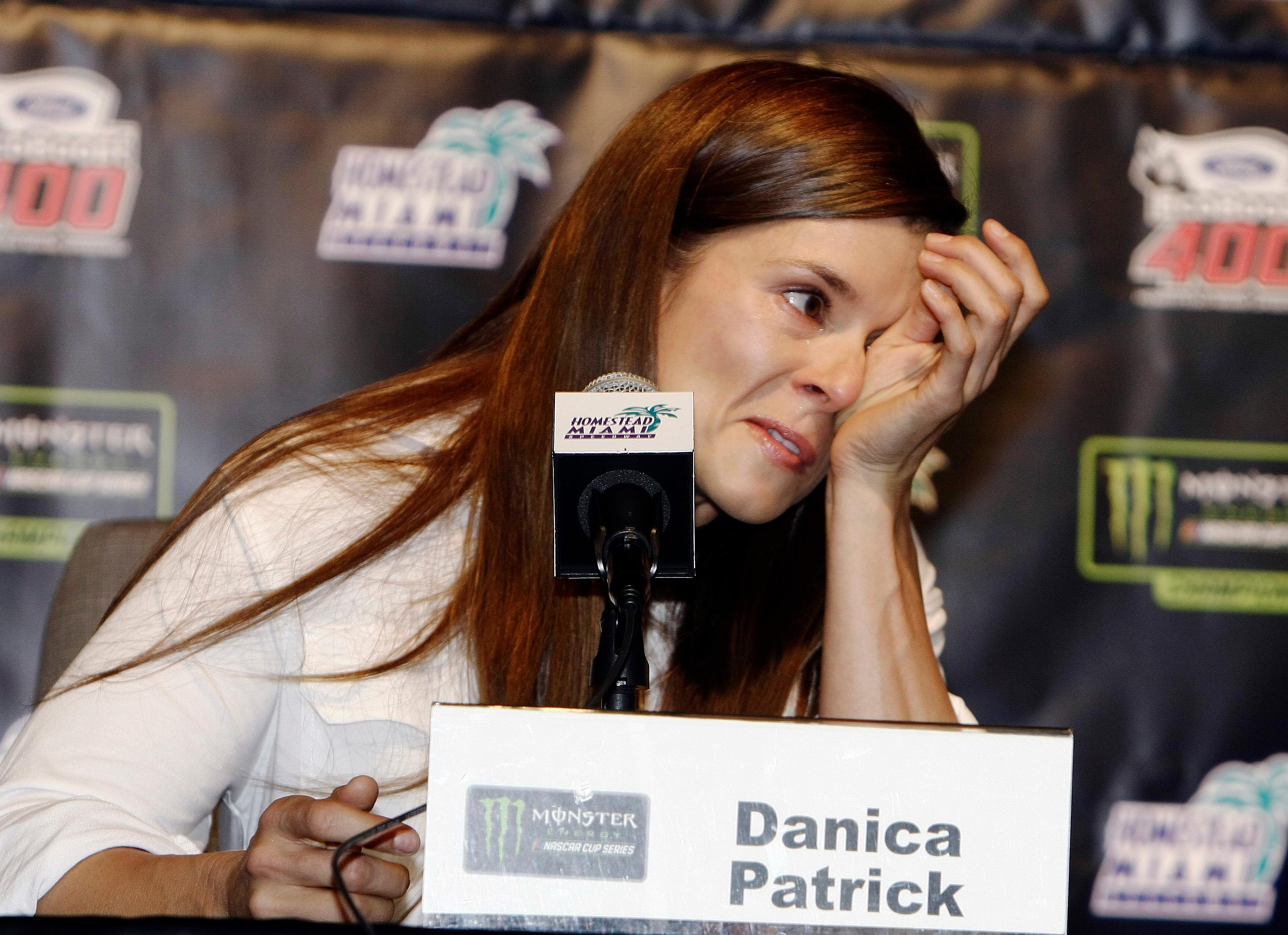 Danica Patrick wipes away tears as he speaks with the media during a news conference before Sunday's NASCAR Cup Series auto race at Homestead-Miami Speedway in Homestead, Fla., Friday, Nov. 17, 2017. Patrick will end her full-time racing career after running in next year's Daytona 500 and Indianapolis 500. ( AP Photo/Darryl Graham)