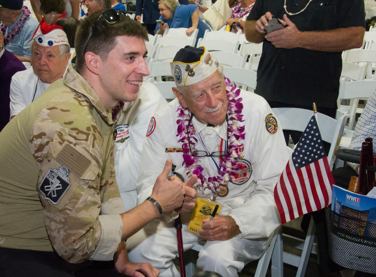 A man poses with a Pearl Harbor survivor on Wednesday, Dec. 7, 2016 at Kilo Peir in Honolulu. Survivors of the Japanese attack, dignitaries and ordinary citizens attended a ceremony at Kilo Pier to commemorate the 75th anniversary of the Japanese attack on the naval harbor.   (Craig T. Kojima/The Star-Advertiser via AP, Pool)