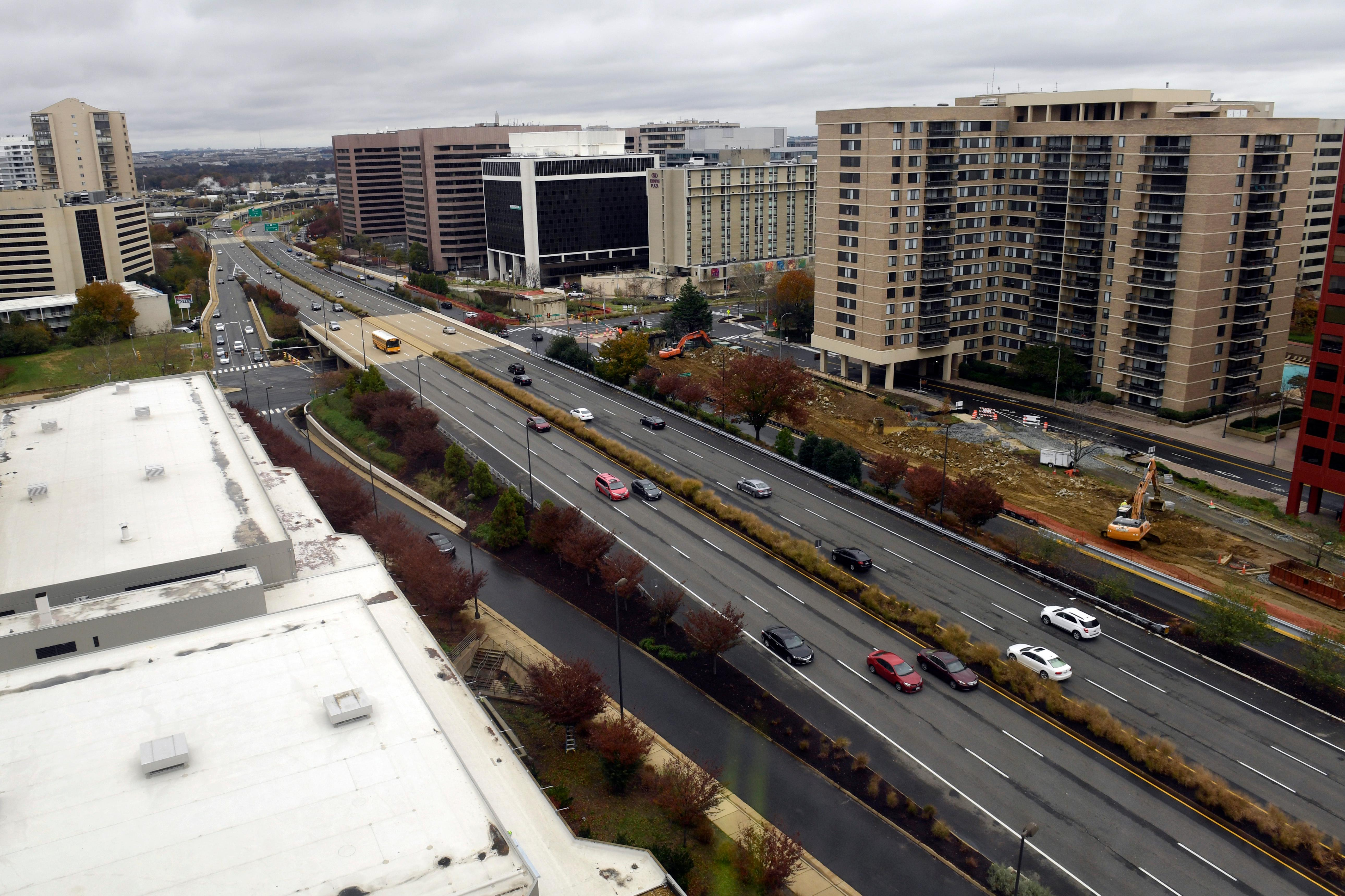 FILE- This Tuesday, Nov. 13, 2018, file photo shows a view of Crystal City, Va. On Tuesday, Nov. 13, Amazon said it will split its second headquarters between Long Island City in New York and Crystal City. (AP Photo/Susan Walsh, File)