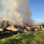 100 tons of hay and shed burn south of Fresno