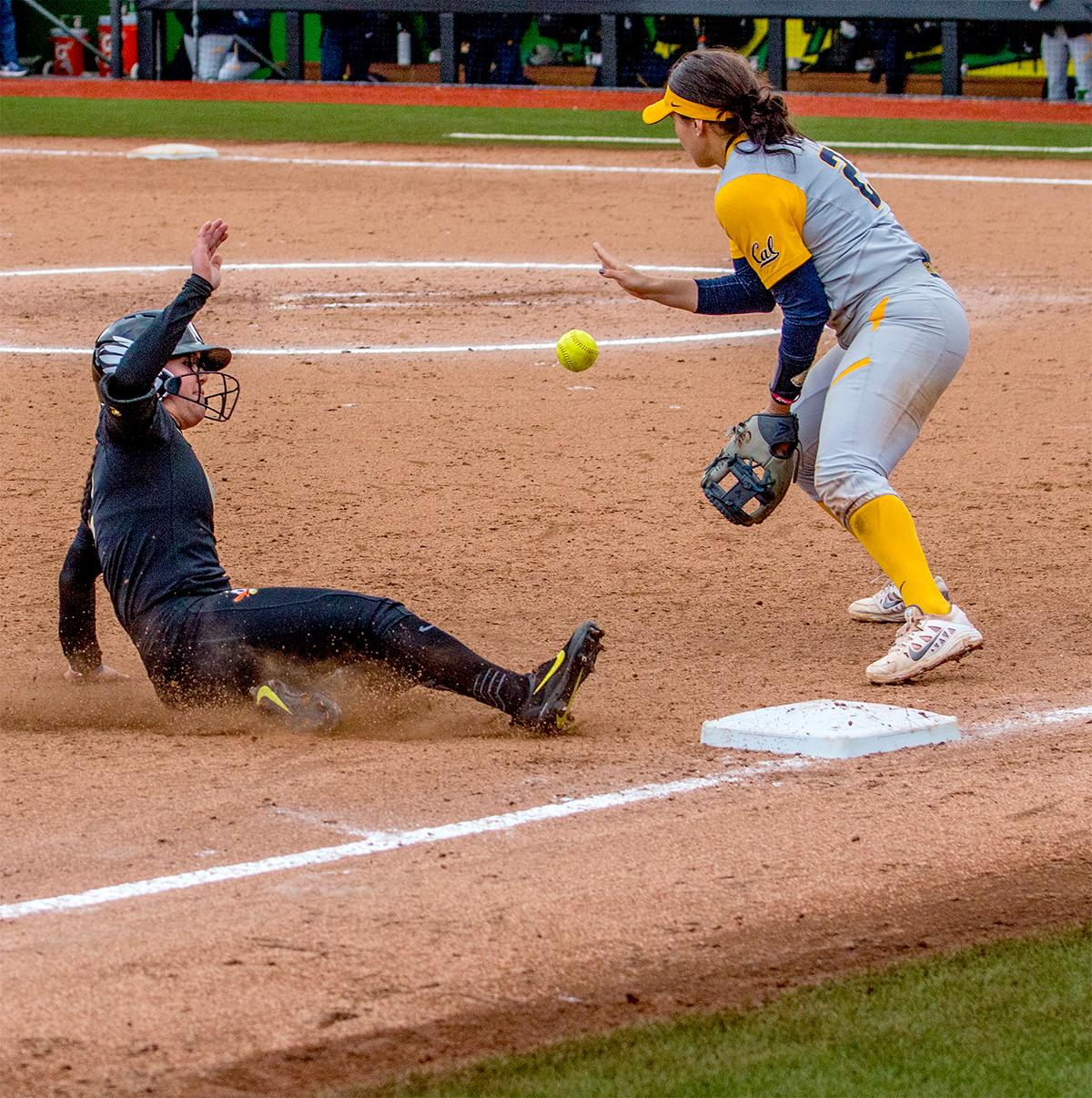 The Duck's Danica Mercado (#2) slides into third base. The Oregon Ducks defeated the Cal Golden Bears 2-1 in the second game of the three game series. Photo by August Frank, Oregon News Lab