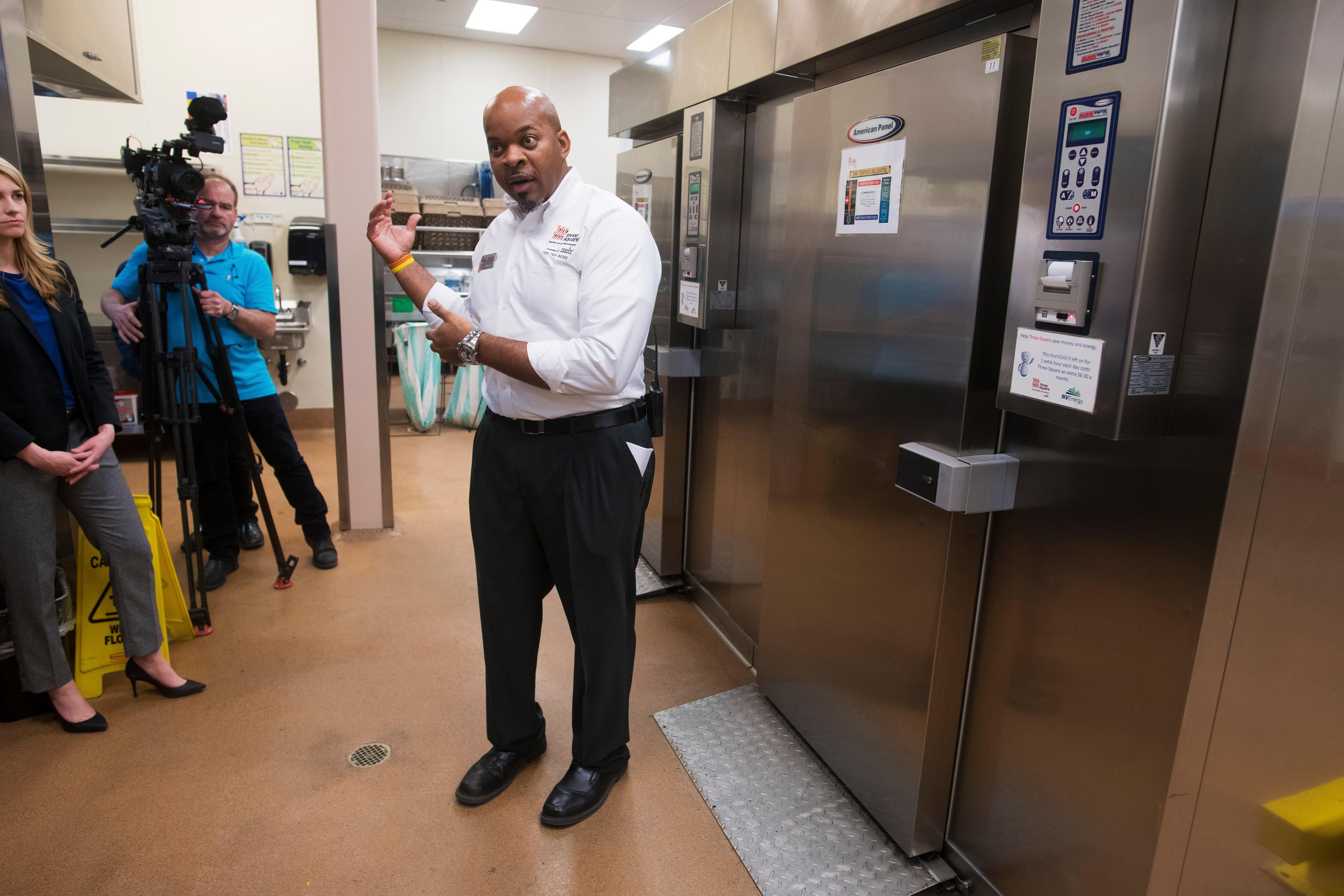 Three Square Director of Operations Maurice Johnson describes how excess banquet food frozen in the blast chillers behind him during an event announcing a partnership between MGM Resorts International and Three Square food bank to expand their surplus banquet food rescue program Wednesday, January 17, 2018. CREDIT: Sam Morris/Las Vegas News Bureau