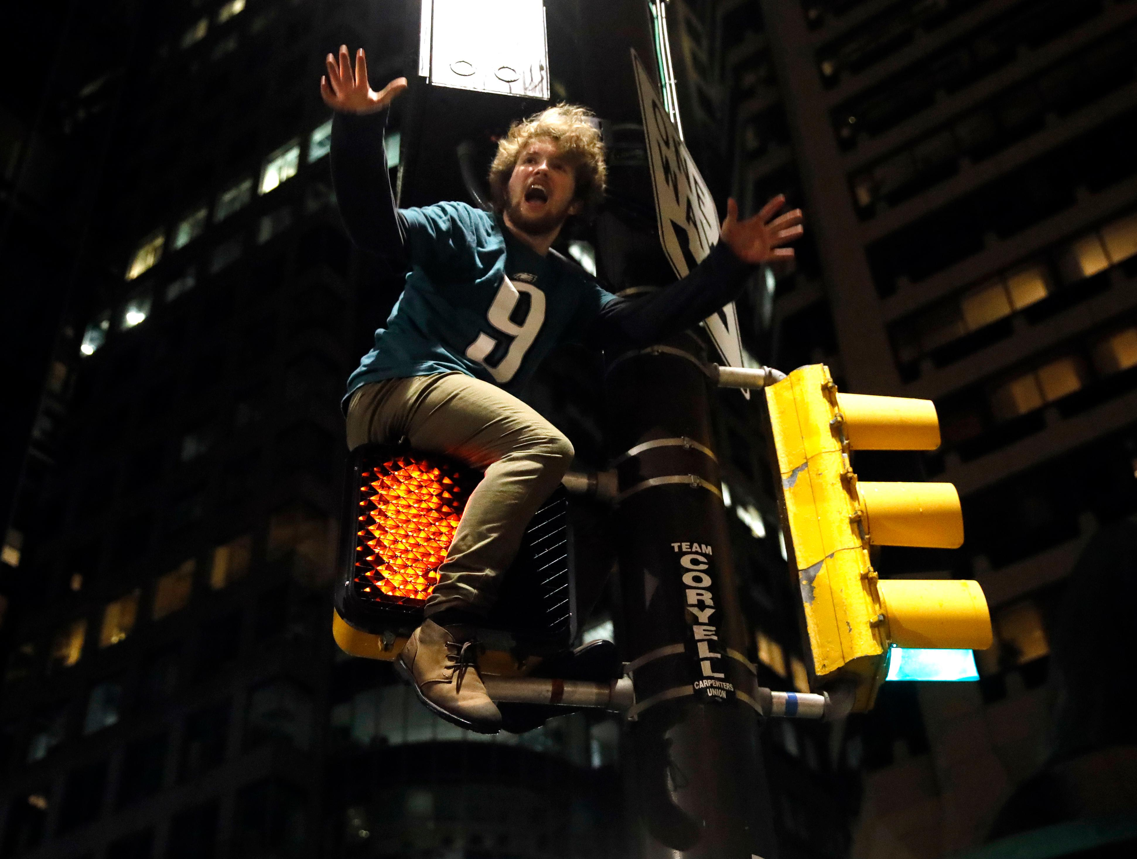 A Philadelphia Eagles fan celebrates the team's victory in the NFL Super Bowl 52 between the Philadelphia Eagles and the New England Patriots, Sunday, Feb. 4, 2018, in downtown Philadelphia. (AP Photo/Matt Rourke)