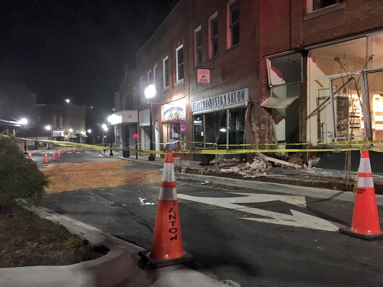 The scene on Main Street in Canton after a police chase ended in an SUV crashing into a building. (Photo credit: WLOS staff)