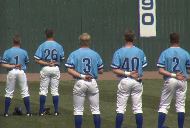 Members of the UNK baseball team stand for the national anthem on April 11, 2018 (KHGI)