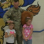 Soldier surprises daughters after 5-month deployment