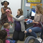 Middle school student knits 73 scarves for 2nd grade elementary classes