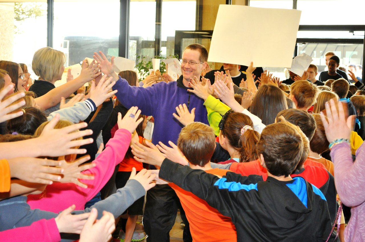 Wylie coach Russell Perkins was mobbed by young Wylie fans during a send-off Wednesday. The Bulldogs (34-4) are headed to Austin to compete in the state basketball tournament.Photo by Kerr Broadstreet/WylieSports.com