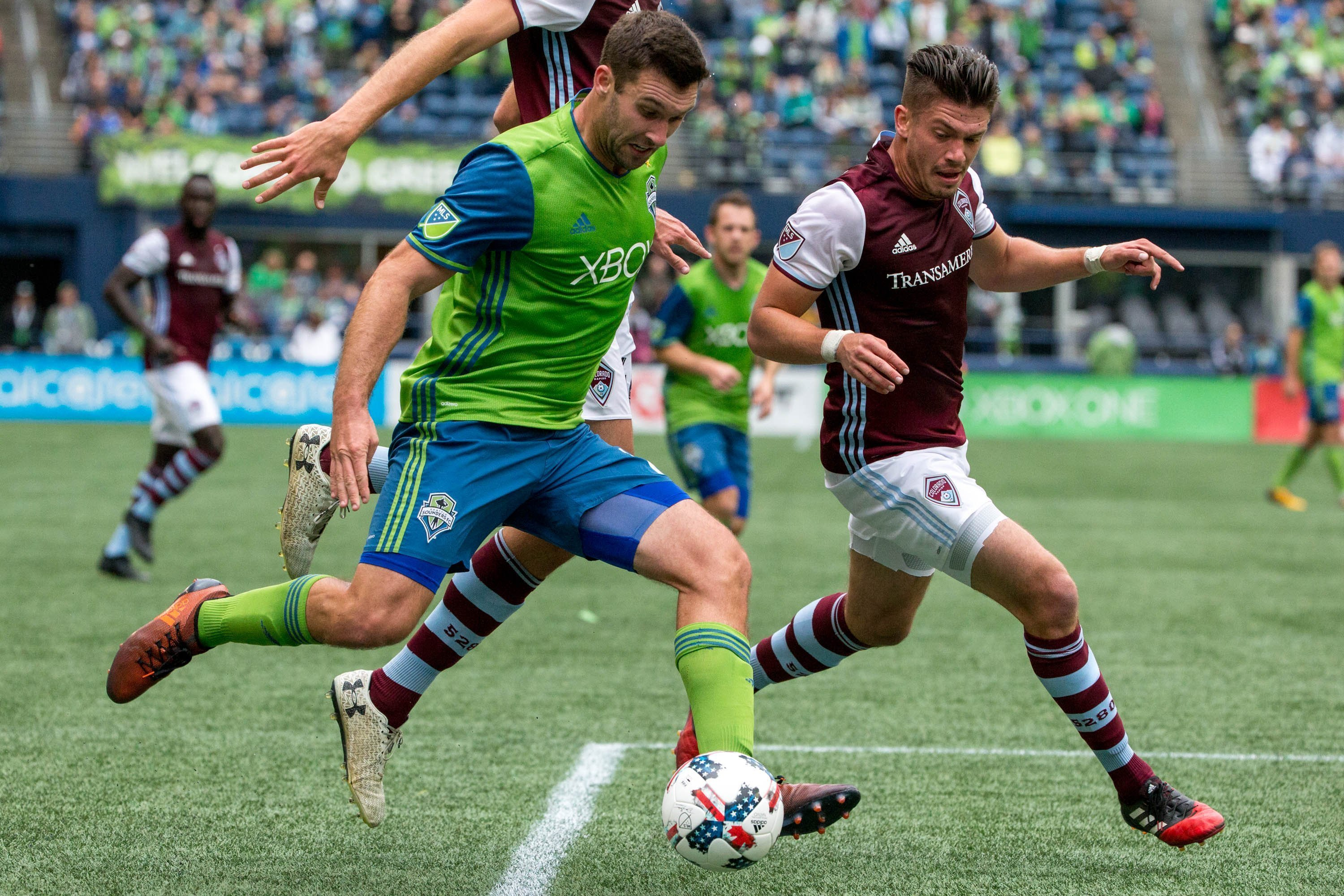 Seattle Sounders defender Will Bruin (17) gets the ball past Colorado Rapids defender Mike da Fonte (2) during the first half of an MLS soccer game in Seattle on Sunday, Oct. 22, 2017. (Courtney Pedroza/The Seattle Times via AP)