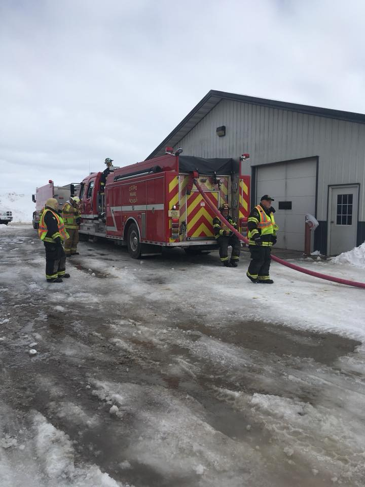 Fire crews working to remove snow from the roof of a barn. (Photo courtesy{ }Cindy Birling)