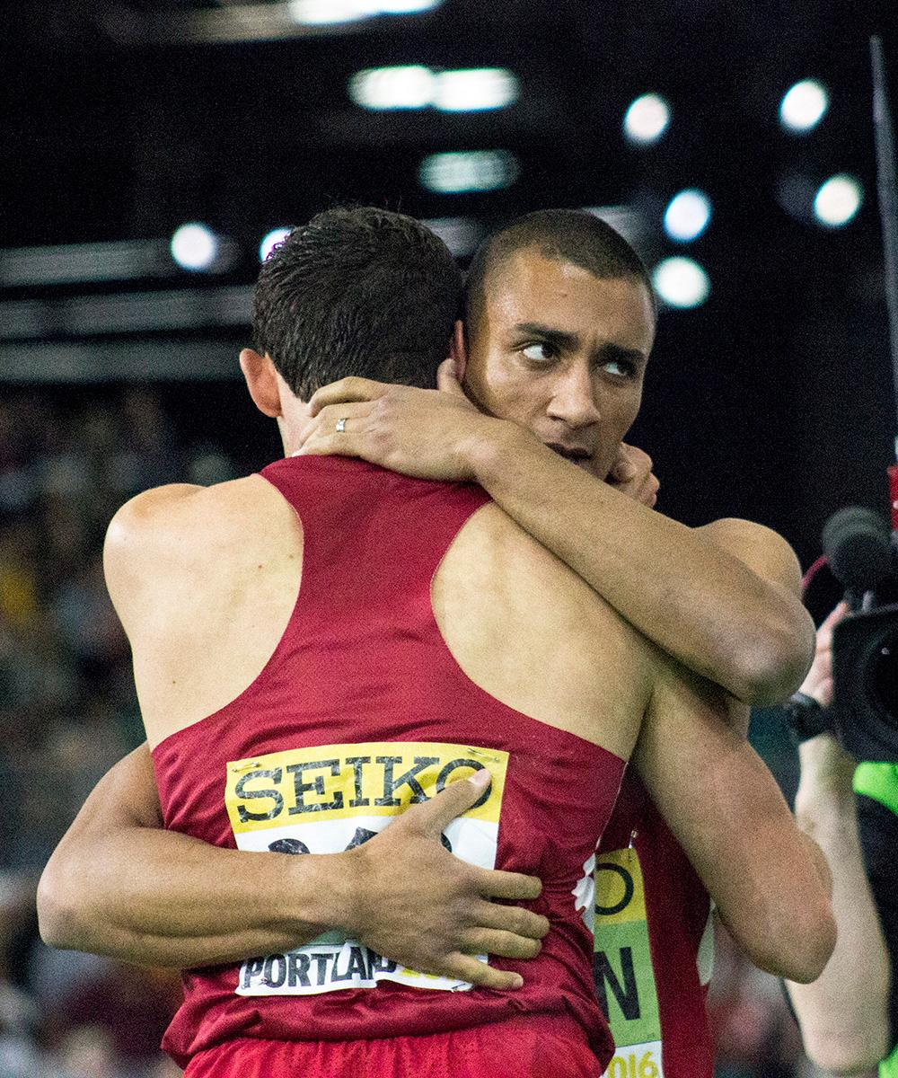 Ashton Eaton embraces fellow U.S.A. athlete Curtis Beach after the men's 1000 meter race. Beach placed first in the race, but Eaton was the overall winner in the men's heptathlon. Photo by Amanda Butt