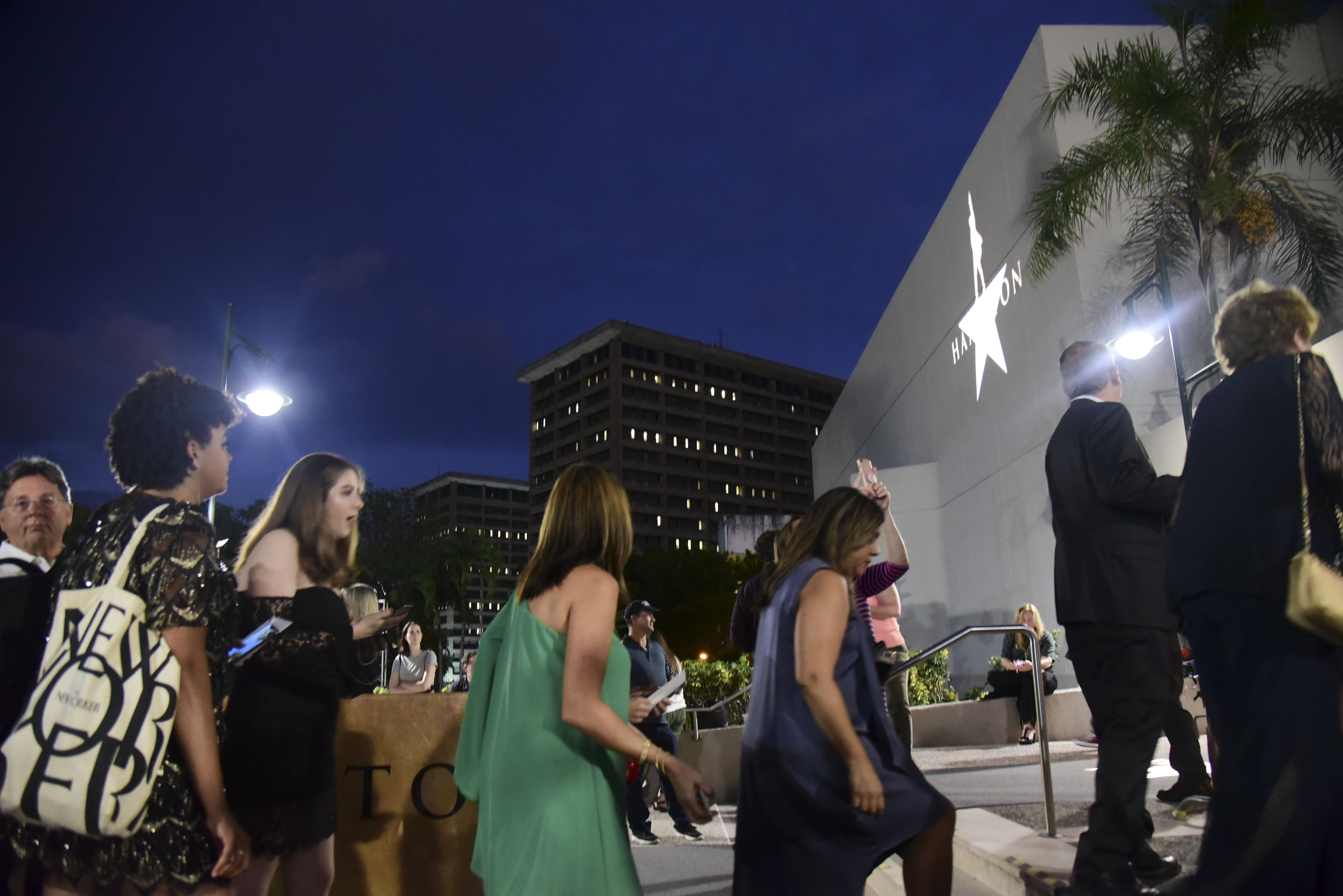 People line up in the entrance plaza of the Santurce Fine Arts Center moments before the premiere of the award-winning Broadway musical, Hamilton, starring its creator, New York native of Puerto Rican descent Lin-Manuel Miranda, in San Juan, Puerto Rico, Friday Jan. 11, 2019. The musical is set to run for two weeks and will raise money for local arts programs. (AP Photo/Carlos Giusti)