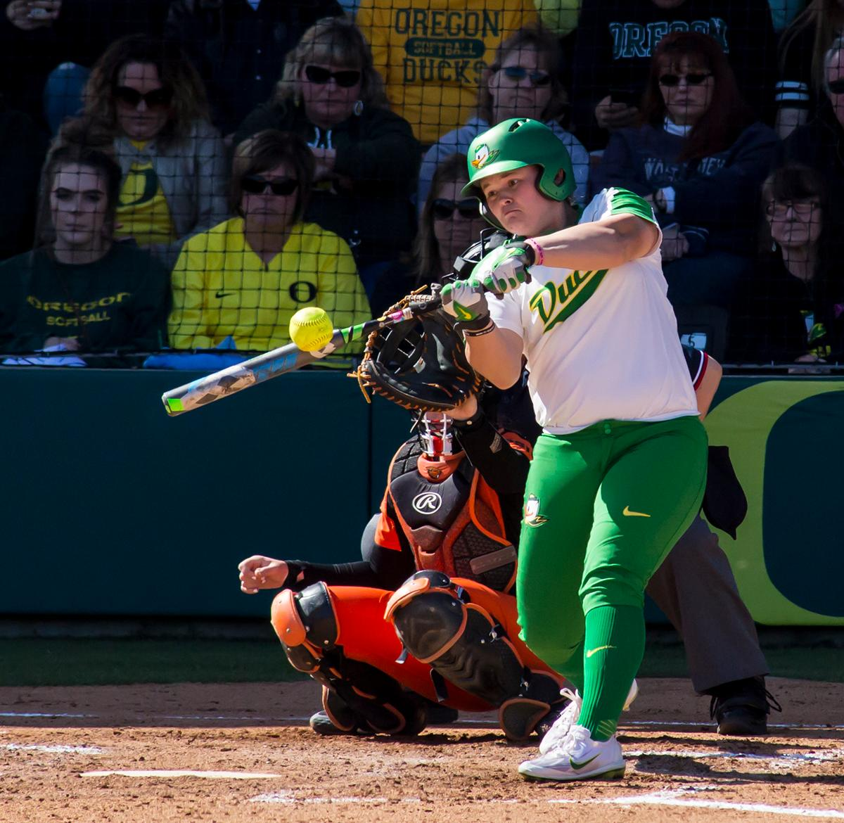 Oregon designated player Madi Bishop (#23) hits the ball into the outfield. The Oregon Ducks defeated the Oregon State Beavers seven to zero on Sunday, April 30, 2017. The Ducks' victory marked the third victory of the three game sweep against the Beavers. Photo by Ben Lonergan, Oregon News Lab