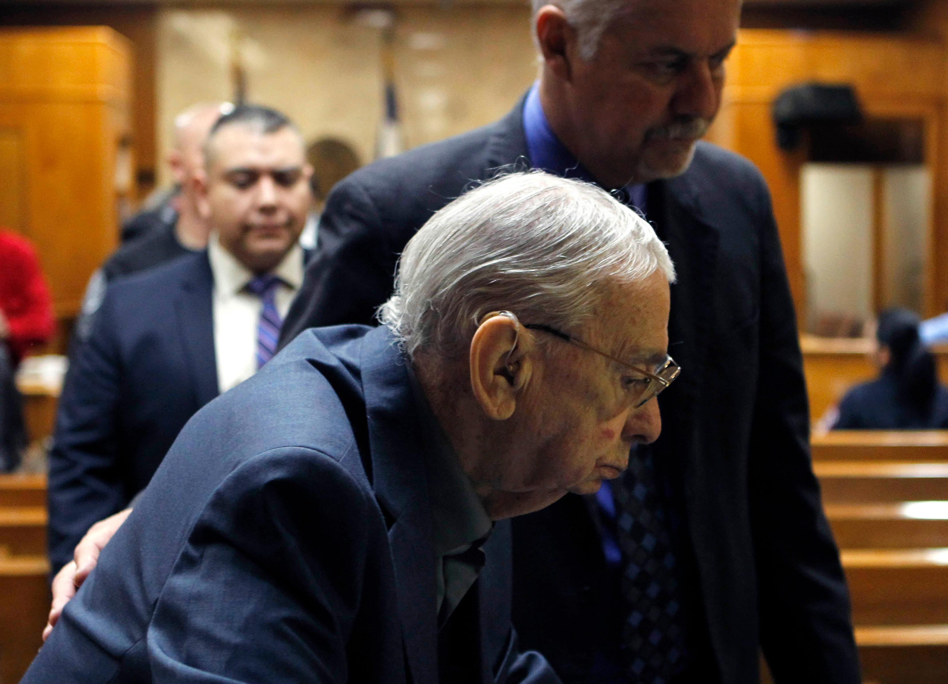 John Bernard Feit leaves the 92nd state District Court with defense attorney A. Ricardo Flores during a break in testimony in Feit's trial for the 1960 murder of Irene Garza Wednesday, December 6, 2017, at the Hidalgo County Courthouse in Edinburg. (Nathan Lambrecht/The Monitor/Pool)