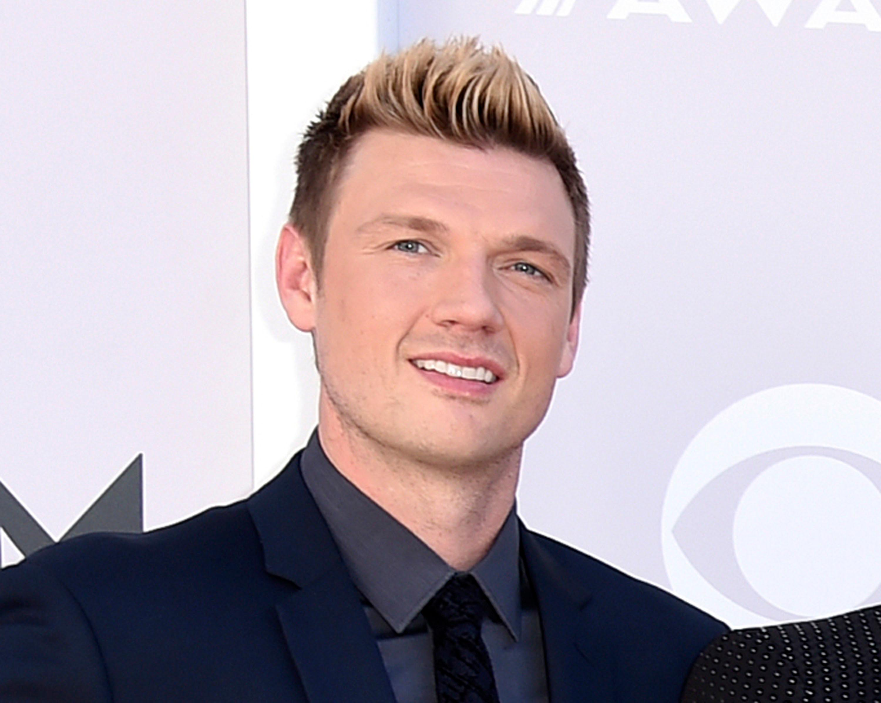 "FILE - In this April 2, 2017 photo, Nick Carter of the Backstreet Boys arrive at the 52nd annual Academy of Country Music Awards in Las Vegas. Carter says he's ""shocked and saddened"" by accusations made by a singer who said he raped her about 15 years ago. Melissa Schuman of the girl group Dream wrote in a blog post that she was ""forced to engage in an act against my will."" She said the Backstreet Boy took her virginity. (Photo by Jordan Strauss/Invision/AP, File)"
