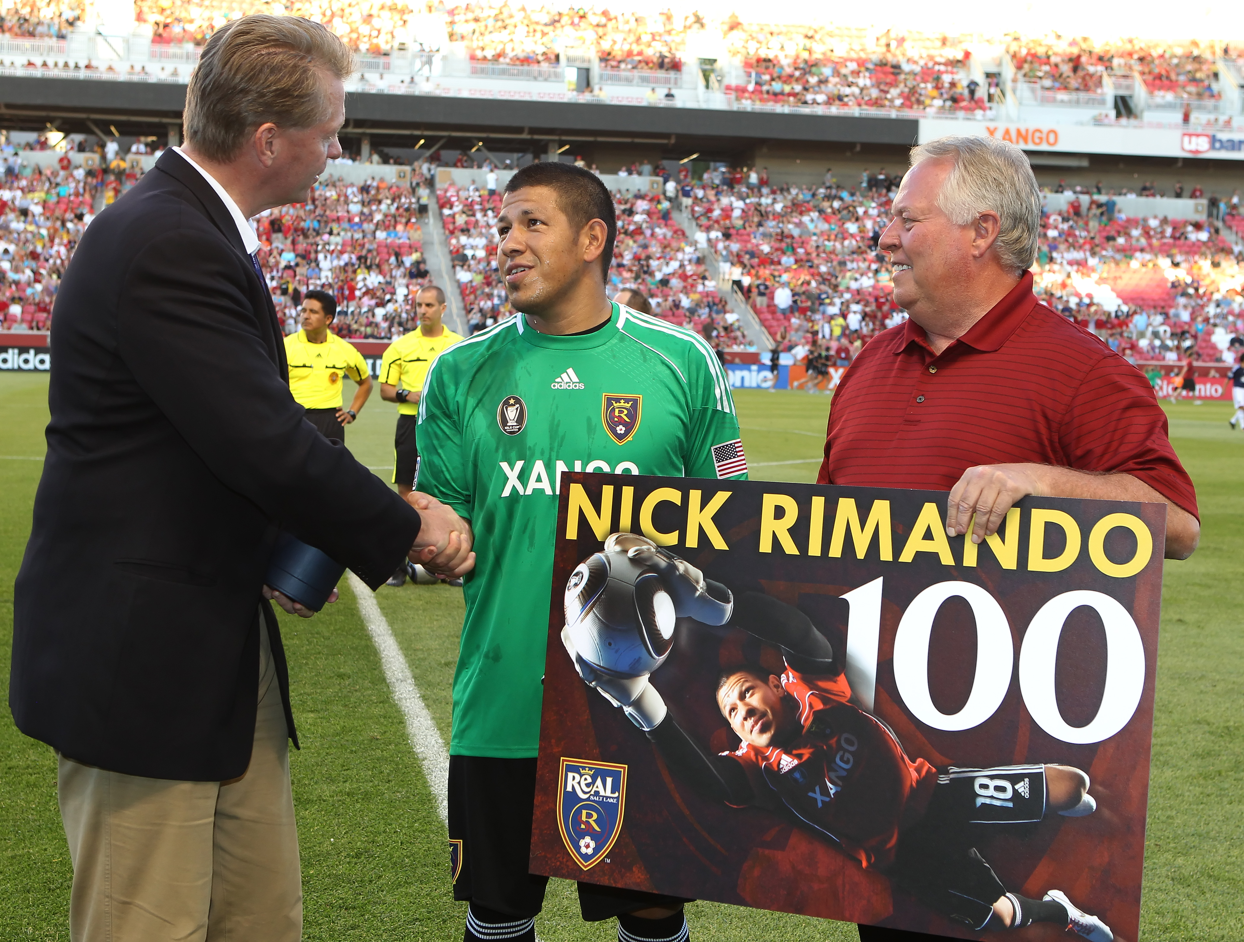 SANDY, UT - JULY 24: Owners of Real Salt Lake Dave Checketts (L) and Dell Loy Hansen (R) awards a ring to Real Goalie Nick Rimando #18 for his 100th win before a game against Chivas USA at an MLS soccer game July 24, 2010 at Rio Tinto Stadium in Sandy, Utah. (Photo by George Frey/Getty Images)