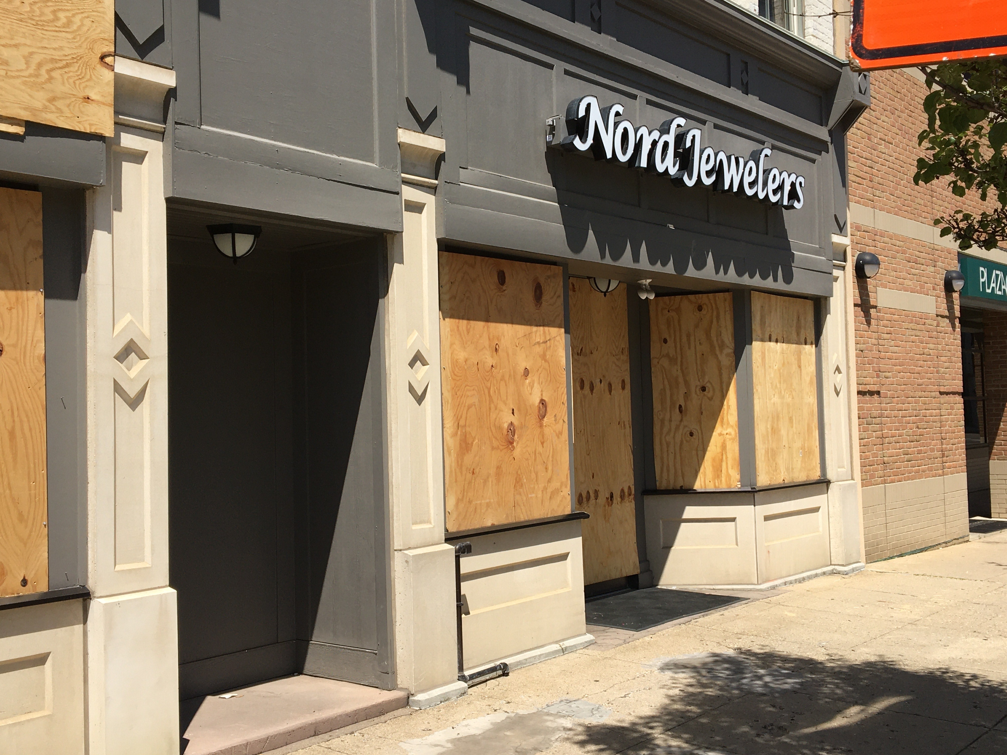 Owners and managers of Nord Jewelers decided to board up the shop on West Michigan Avenue in downtown Kalamazoo after the city announced a curfew starting at 7 p.m. (WWMT/Manny Revilla)