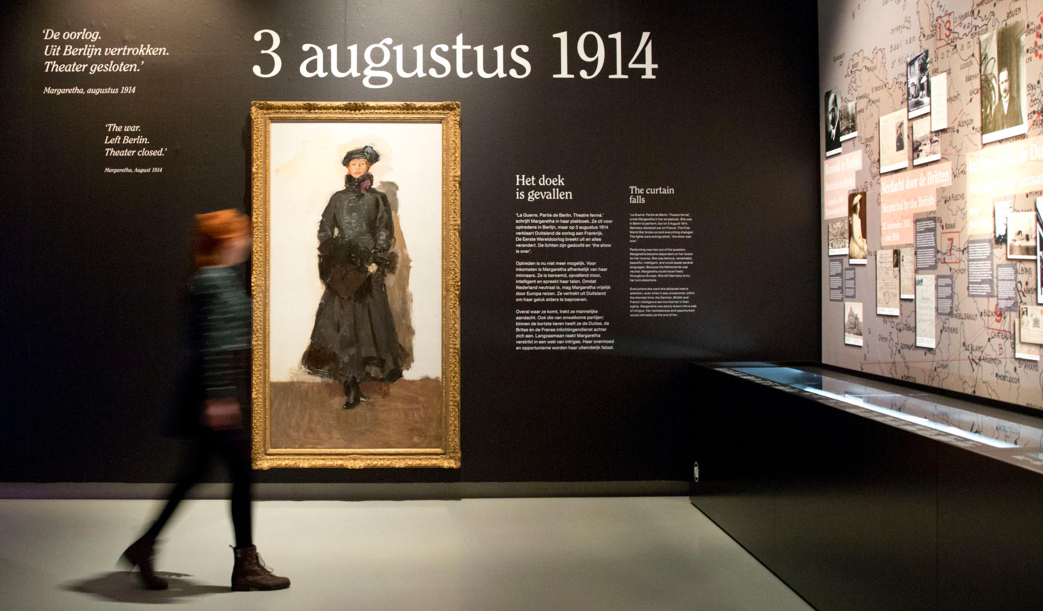 In this photo taken on Friday, Oct. 13, 2017, a visitor walks past an oil painting of Margaretha Zelle, also known as Mata Hari, painted by Isaac Israel's in 1916, and on display at the Fries Museum in Leeuwarden, Netherlands. A century ago, on Oct. 15, 1917, an exotic dancer named Mata Hari was executed by a French firing squad, condemned as a sultry Dutch double agent who supposedly led tens of thousands of soldiers to their death during World War I. (AP Photo/Virginia Mayo)