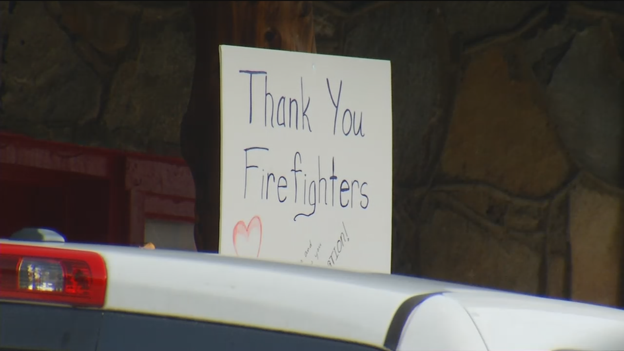 Tuesday's rain meant the end of a long, hard job for nearly 200 firefighters working the Party Rock fire.  Now that the fire is 100 percent contained, they'll soon be headed home. (Photo credit: WLOS staff)