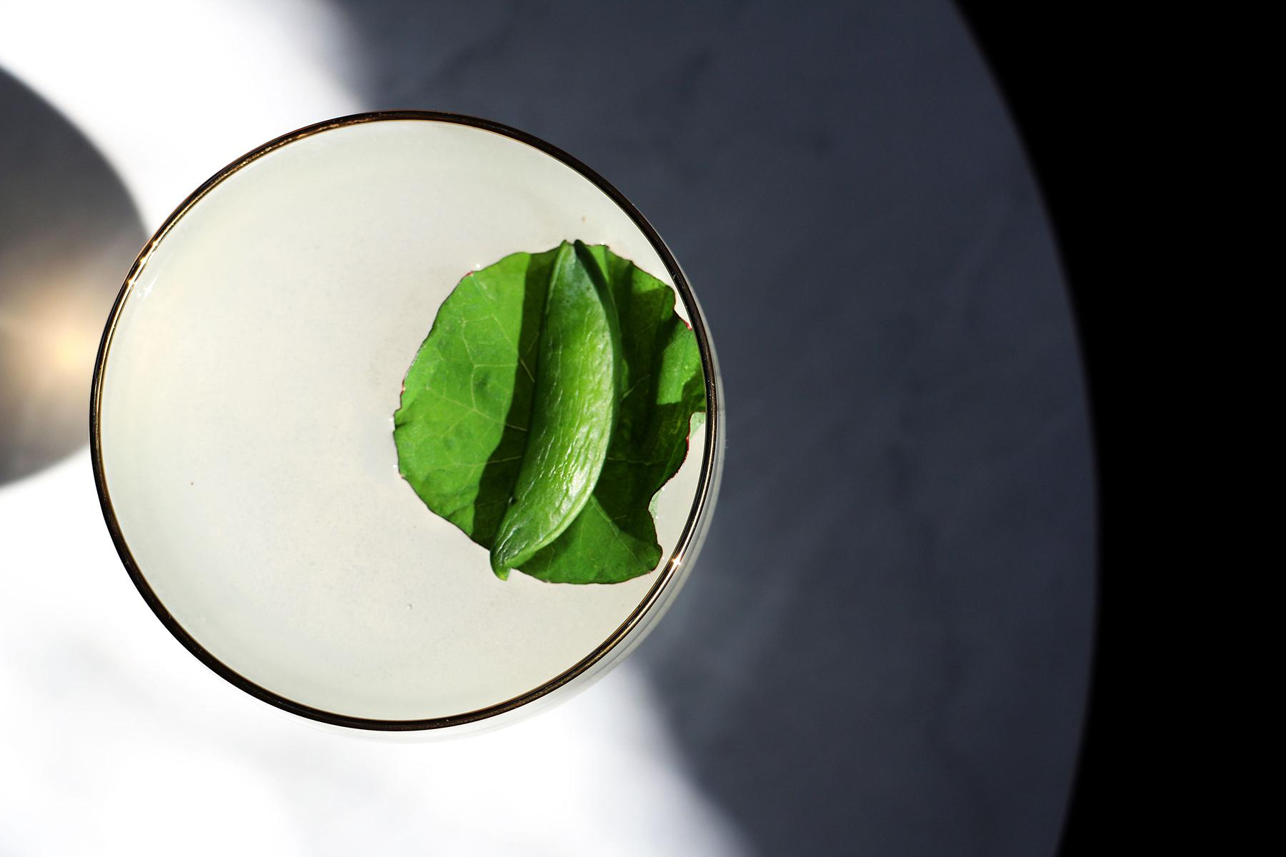 "The Goddess Strikes: Shakes vodka with Lillet Blanc, snap peas, Persian lime and sugarcane. ""Again the goddess strikes the golden lyre, and tunes to wilder notes the warbling wire, with soft suspended step attention moves, and silence hovers o'er the listening groves."" (Image: Jai Williams)"