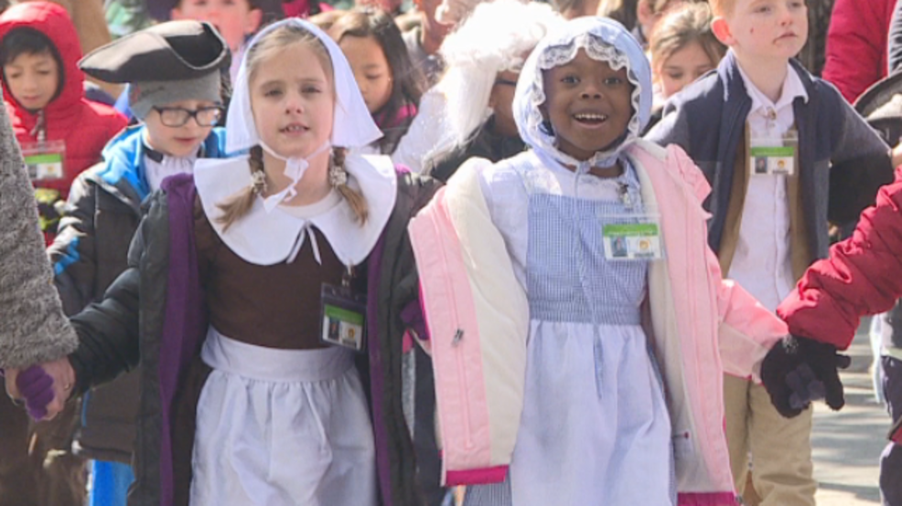Local students march through Savannah streets in costumes for Georgia Day Parade