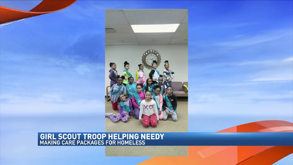 girl scouts collect donations for care packages for the