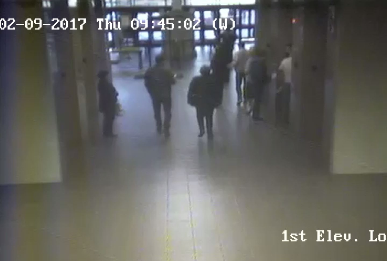Surveillance video from the El Paso County courthouse shows what county officials say are ICE agents escorting a woman outside the courthouse from a protective order hearing. Credit: El Paso County