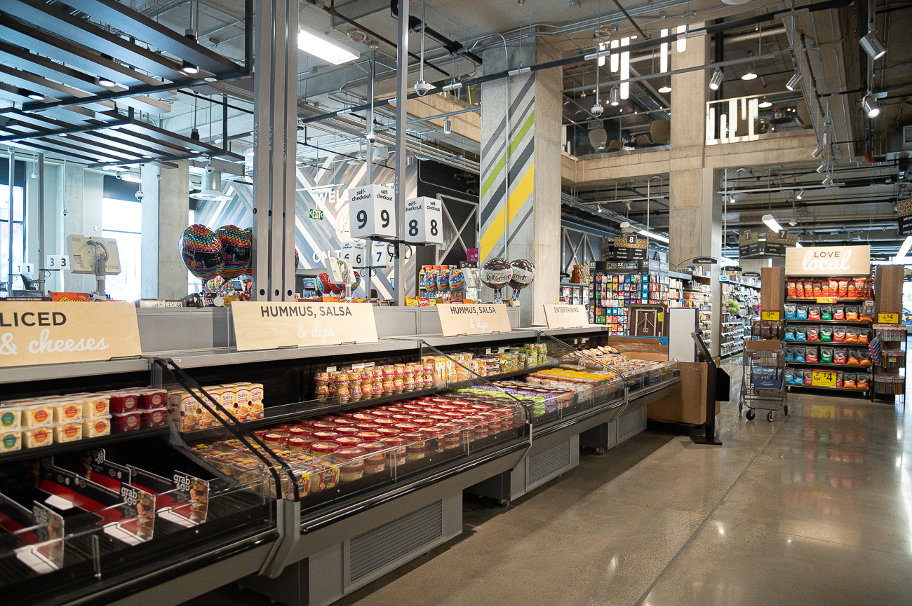 The two-story grocery store is tailored to urban life and breaks from the suburban big-box model by occupying a smaller footprint and streamlining the shopping experience. Instead of focusing on regular big shopping excursions, the store is set up to encourage convenience and quick trips for residents and Downtown workers. Kroger On the Rhine is the first time the corporation has had a store in the Central Business District in many years. It is a block away from Kroger's world headquarters, and will be open from 6 AM to 10 PM every day of the week. ADDRESS: 100 E. Court Street / Image: Phil Armstrong, Cincinnati Refined // Published: 9.24.19