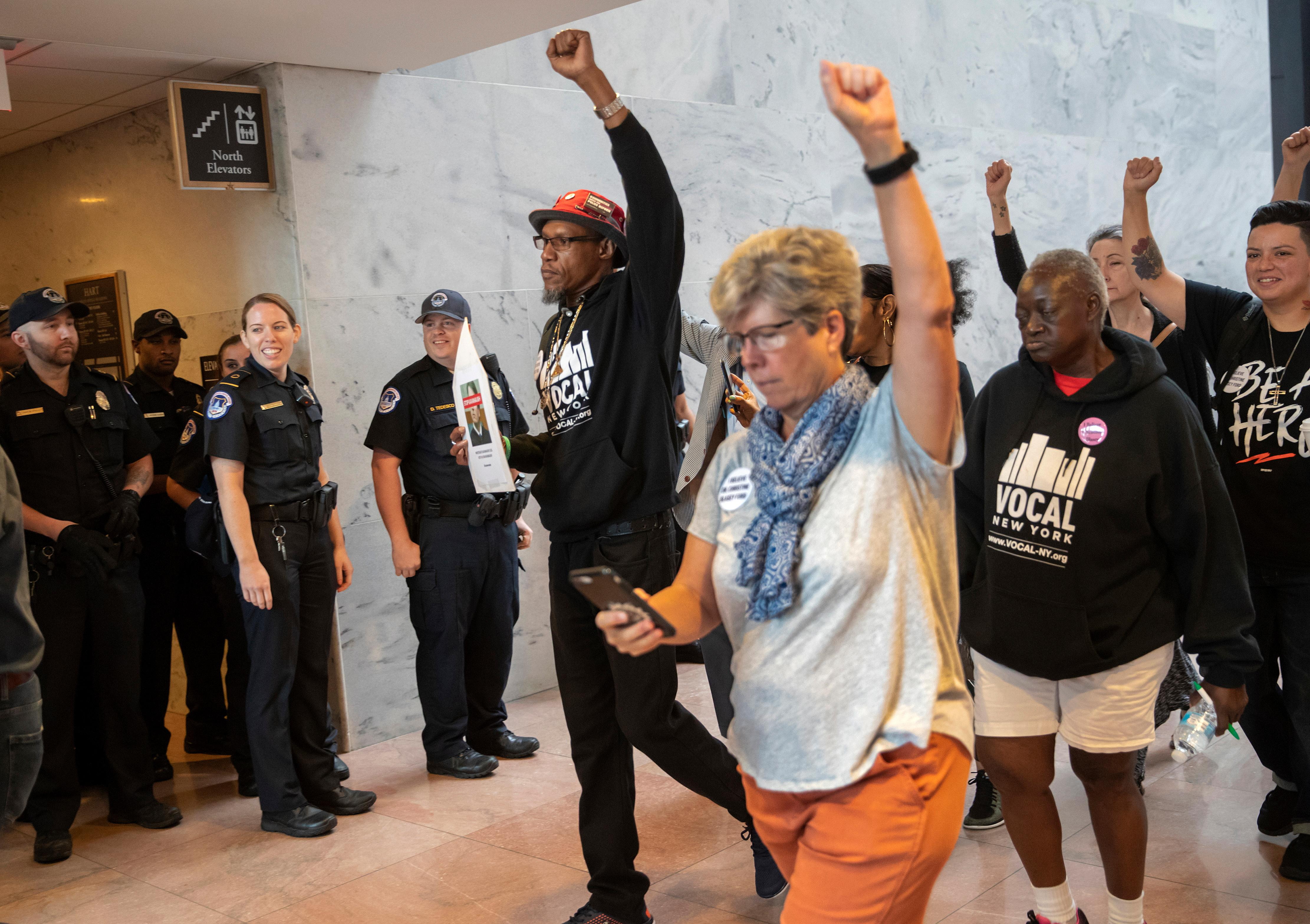 Protesters opposed to President Donald Trump's Supreme Court nominee, Brett Kavanaugh, demonstrate in the Hart Senate Office Building on Capitol Hill in Washington, Thursday, Sept. 20, 2018. (AP Photo/J. Scott Applewhite)