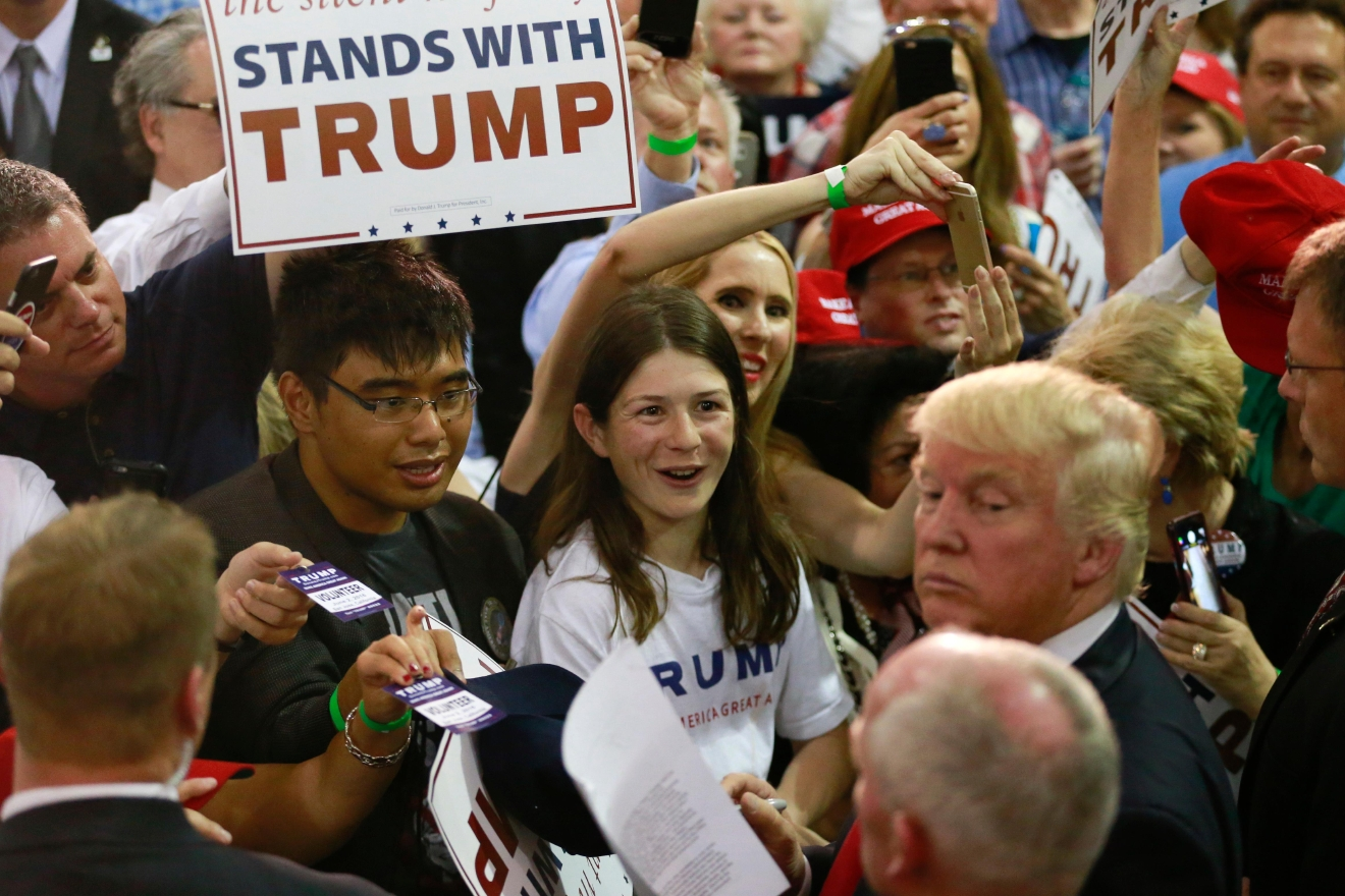 Supporters react as they greet with Republican presidential candidate Donald Trump during a rally Thursday, June 2, 2016, in San Jose, Calif. (AP Photo/Jae C. Hong)
