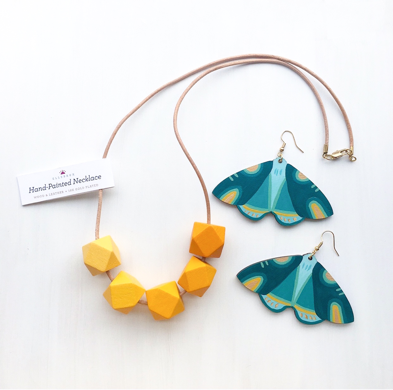 A hand-painted wooden necklace and hand-painted wooden moth earrings / Image: courtesy of Ellebrux{&nbsp;}// Published: 3.26.20<br><p></p>