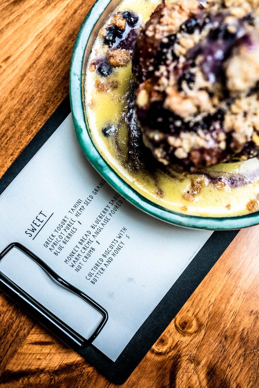 Monkey Bread with blueberry sauce, warm creme anglaise poured over a nut crumb / Image: Amy Elisabeth Spasoff // Published: 2.6.18