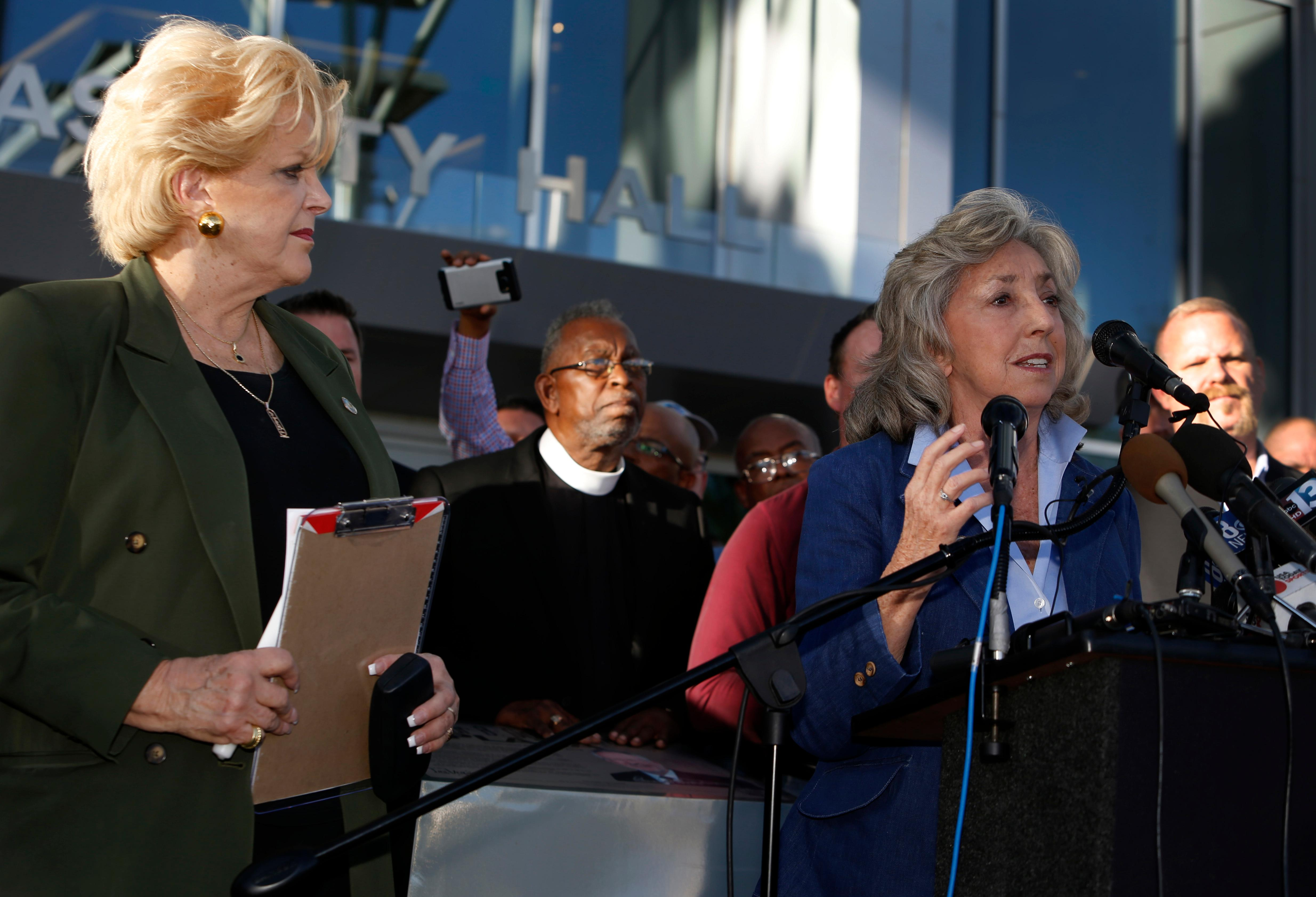 Las Vegas Mayor Carolyn Goodman, left, listens to Congresswoman Dina Titus, D-Nev., during a prayer vigil in honor of those affected by the shooting on the Las Vegas Strip, in front of Las Vegas City Hall in Las Vegas, Monday, Oct. 2, 2017. The vigil was held in honor of the over 50 people killed and hundreds injured in a mass shooting at an outdoor music concert late Sunday. (Steve Marcus/Las Vegas Sun via AP)