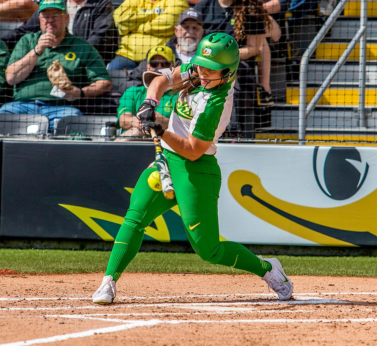 The Duck's Mia Camuso (#7) connects with the ball in a downward trajectory. The Oregon Ducks Softball team took their third win over the Arizona Sun Devils, 1-0, in the final game of the weekends series that saw the game go into an eighth inning before the Duck?s Mia Camuso (#7) scored a hit allowing teammate Haley Cruse (#26) to run into home plate for a point. The Ducks are now 33-0 this season and will next play a double header against Portland State on Tuesday, April 4 at Jane Sanders Stadium. Photo by August Frank, Oregon News Lab