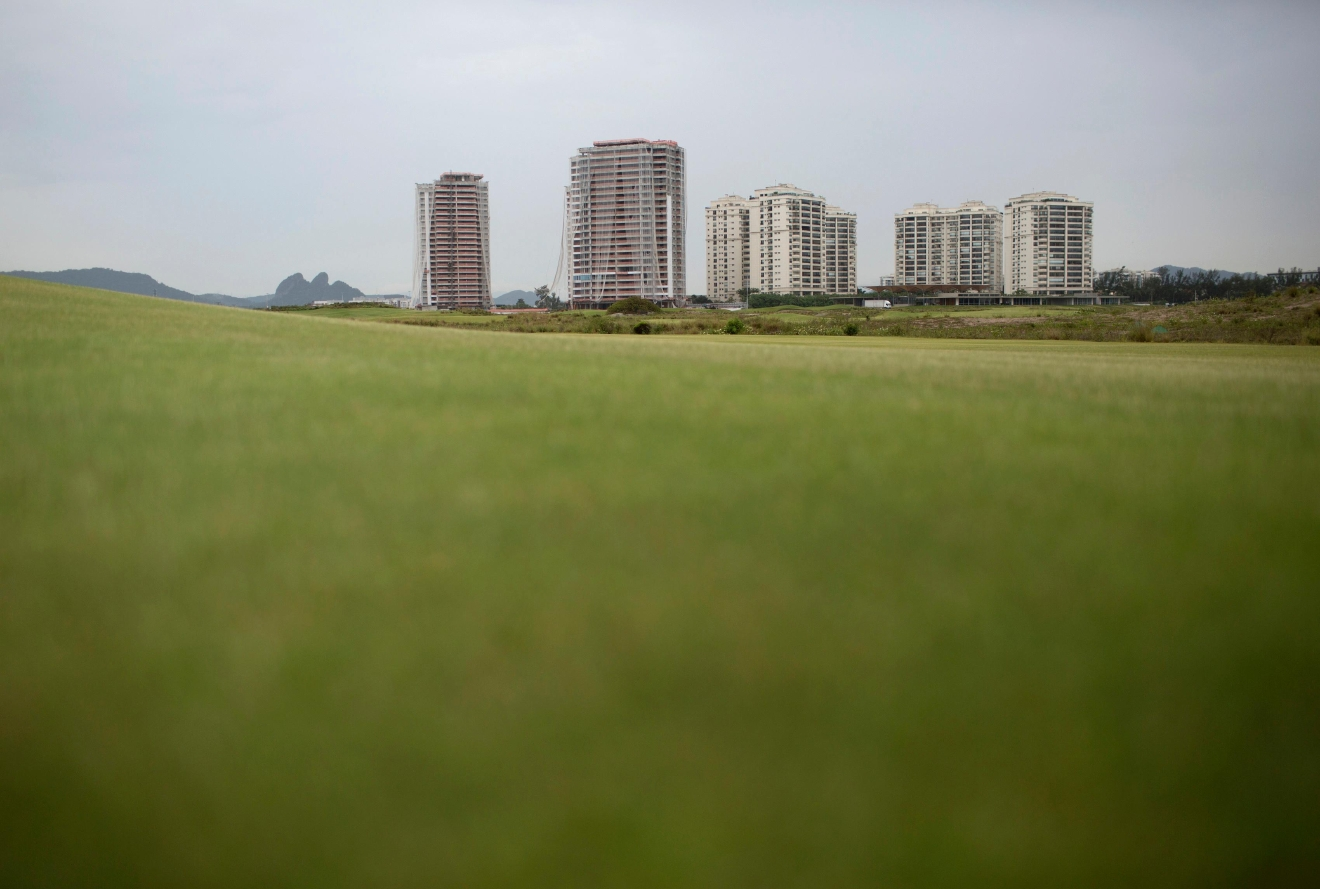"FILE - This Dec. 14, 2016 file photo shows luxury apartments known as ""Riserva Golf,"" off the Olympic golf course in Rio de Janeiro, Brazil, which won't be completed until 2018. In a deal with the city, billionaire developer Pasquale Mauro spent about $20 million to build the course in exchange for permission to construct the multi-million-dollar apartments on some of Rio's most desirable real estate. (AP Photo/Silvia Izquierdo, File)"