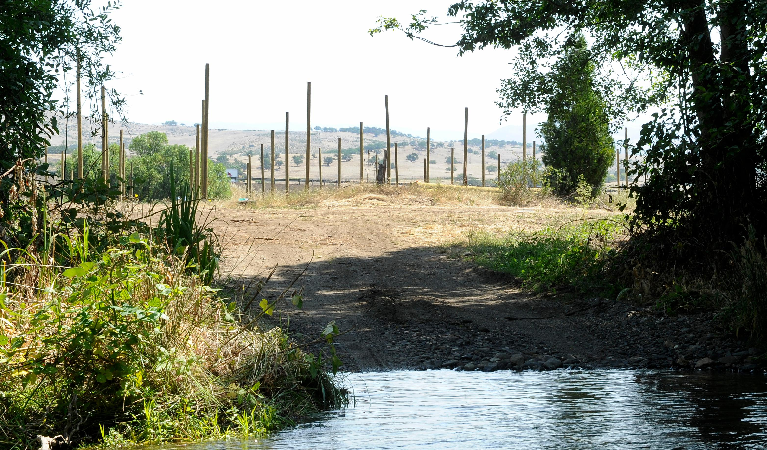 Andy Atkinson / Mail Tribune<br>The entrance through Bear Creek to the hop fields in Ashland.