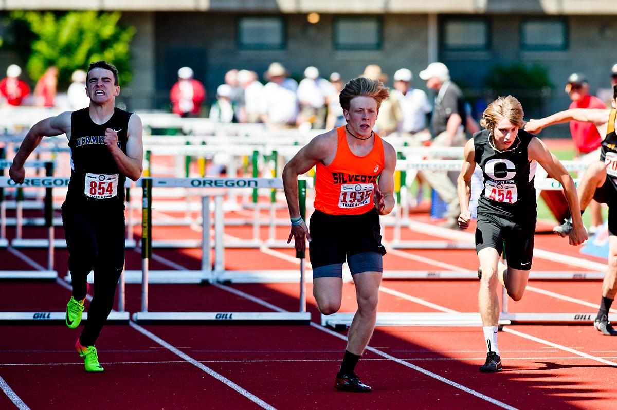 Brock Rogers from Silverton wins the 5A Boys 110 meter Hurdles with a time of 14.47 at the OSAA Championship at Hayward Field on Saturday. Photo by Dan Morrions, Oregon News Lab